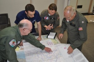 Photo by Ron Darcey, AuxAir volunteers plan patrol mission